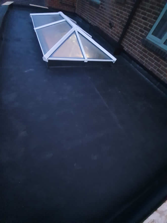 A recently completed firestone rubber roof for a customer in Preston
